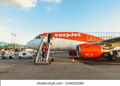 Nantes, France - November 6, 2017: dispatcher inspects an easyJet airline airliner on the tarmac of Nantes airport between two rotation on a fall day