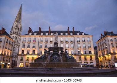 Nantes main square wih a founain on a sunset. Classic European architecture