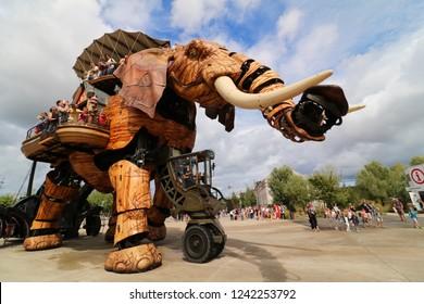 Nantes, Pays de la Loire / France - August 13 2018: Le Grand Elephant. The Grand Elephant. A gigantic mechanical elephant walks around carrying passengers. Landscape orientation.