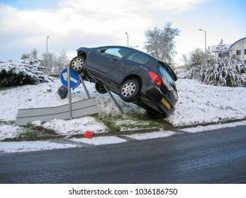 Nantgarw Wales UK 11/25/2005: Car crashed into road sign on icy road