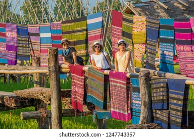 Nan,Thailand - October 8, 2018 : The Local woven fabrics are dried on wooden bridges with tourists at Ban Tai Lue Coffee house in Pua District, Nan Province, Thailand.