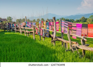 Nan,Thailand - October 8, 2018 : The Local woven fabrics are dried on wooden bridges at Ban Tai Lue Coffee house in Pua District, Nan Province, Thailand.