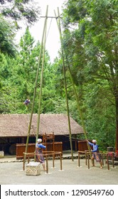 Nantou City, Taiwan - July 15 , 2017 : swing play on a swing at Taiwan Aboriginal houses at Formosan Aboriginal Culture Village in Taiwan.