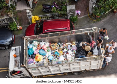 Nantou, Taiwan - April 28th, 2019:white recycling truck for collects recyclable materials in a small lanes at Puli township, Nantou, Taiwan, Asia