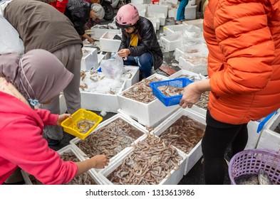Nantou, Taiwan - Jan 31, 2019: people buy fish at the traditional marketplace at Puli town, Nantou, Taiwan.