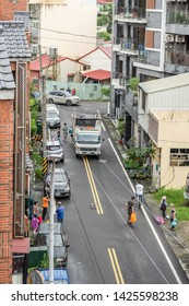 Nantou, Taiwan - Jun 14th, 2019:white recycling truck for collects recyclable materials in a small lanes at Puli township, Nantou, Taiwan, Asia