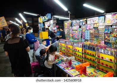 Nantou, Taiwan - May 15th, 2019: night marketplace with vendor and people shop at Puli town, Nantou, Taiwan