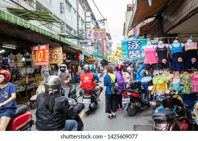 Nantou, Taiwan - May 28th, 2019: people walk and shopping in the traditional market at Puli town, Nantou, Taiwan