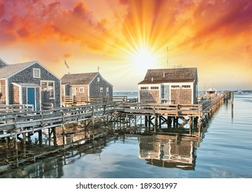 Nantucket, MA. Beautiful Port view with Wooden Homes at sunset.