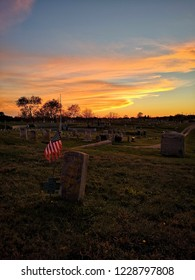 NANTUCKET, MA, USA - NOVEMBER 5,2018.: Beautiful Sunset at Prospect Hill Cemetry with American Flag in Nantucket Island, Massachusetts on November 5, 2018.