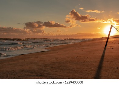 Nantucket ocean waves during sunset.