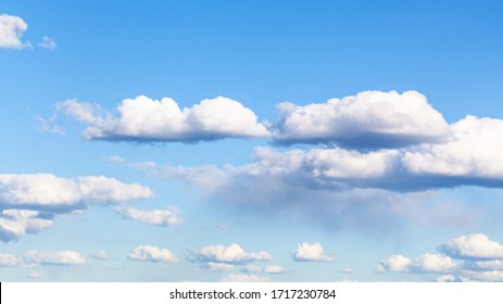 nanural panoramic background - many small cumulus clouds in blue sky on March day
