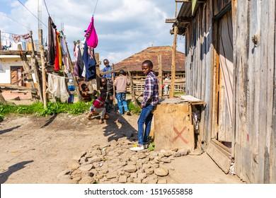 Nanyuki, Laikipia county, Kenya – June 19th, 2019: Impoverished Kenyan children candidly playing in Kenyan suburb.
