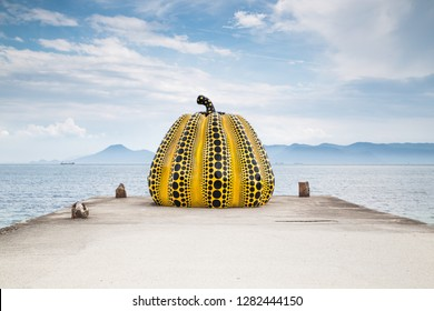 Naoshima, Japan - August 13 2018: Famous yellow Pumpkin artwork on Noashima Island in Japan