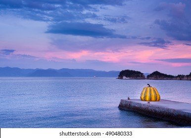 Naoshima, Japan - July 19, 2014: Giant pumpkin objects by Yayoi Kusama that exist in Naoshima. Naoshima is a famous island that there is a lot of art.