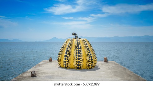 Naoshima, Japan - September 2, 2016: Yayoi Kusama's giant pumpkin sculpture in front of the sea at Naoshima Art island Shikoku,Shikoku is a place famous for Setouchi Art Festival, Japan.