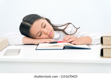 Nap concept. Tired schoolgirl have nap. Little girl taking nap at desk. It is a nap time.