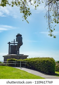 NAPA, CA - April 13, 2018 - Grape Crusher Statue by Gino Miles at the southern entrance to Napa