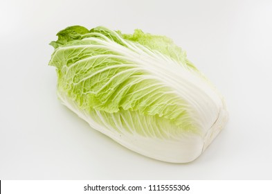 Napa cabbage or Chinese cabbage half, isolated white background