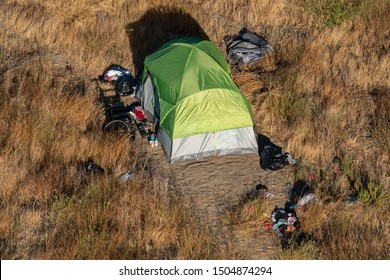 Napa, California - September 8, 2019: Homeless people live in tents in city outskirts in many areas of California, including in the Napa Valley.