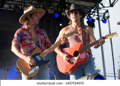 Napa, CA/USA: 5/24/19: (L to R) Cameron Duddy and Mark Wystrach of the band Midland perform at BottleRock. They're an American country music group formed in 2016 in Dripping Springs, Texas.