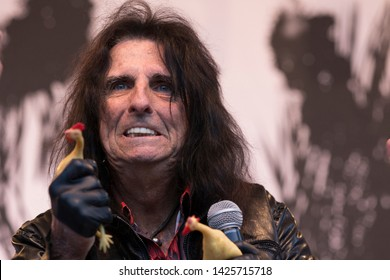 "Napa, CA/USA: 5/26/19: Alice Cooper squeezes chickens to the crowd at BottleRock. He's known as ""The Godfather of Shock Rock"". He's a rock singer, actor, golf celebrity, and DJ."