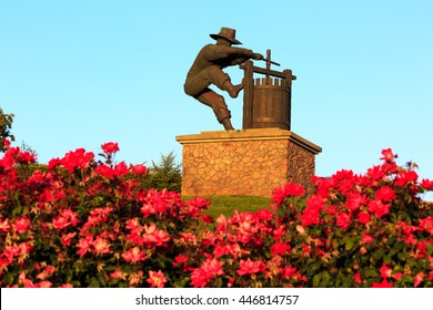 NAPA VALLEY, CALIFORNIA - JUNE 28th, 2016: Winemaker City Statue in the entrance of  Napa Valley California, a man making wine.