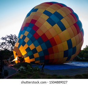 Napa Valley, California - September 8, 2019: Hot air balloons are inflated early in the morning.  The hot air is produced by burning propane gas.
