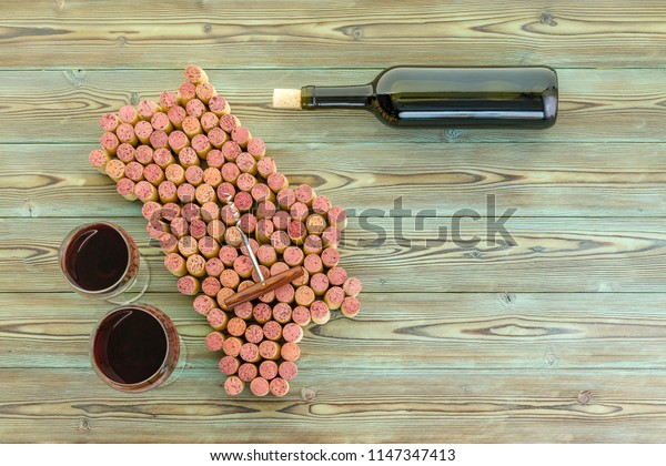 Napa Valley, California wine Region map of wine corks with two full glasses and a bottle of red wine alongside on rustic wood with copy space