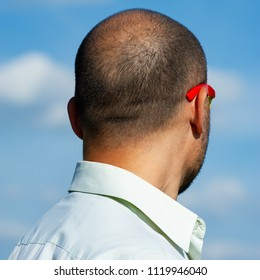 nape of a mature balding man against the sky. Age of forty years.