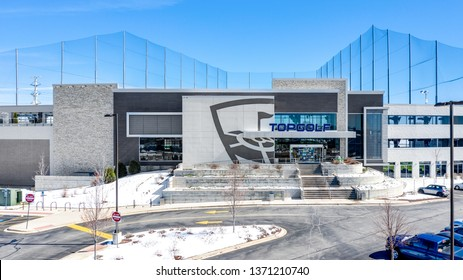 NAPERVILLE, IL, USA - APRIL 15, 2019: A drone / aerial view of TopGolf. Topgolf features three floors of driving range bays and is a fun entertainment complex for all ages to enjoy.