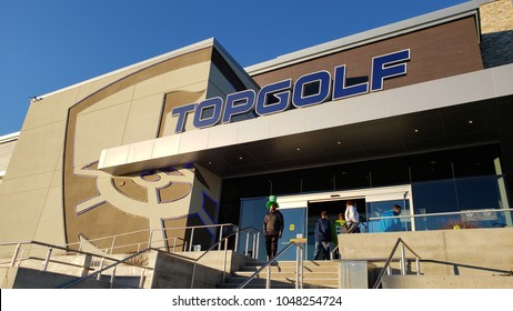 NAPERVILLE, IL, USA - March 17, 2018: Topgolf features three floors of driving range bays and is a fun entertainment complex for all ages to enjoy.