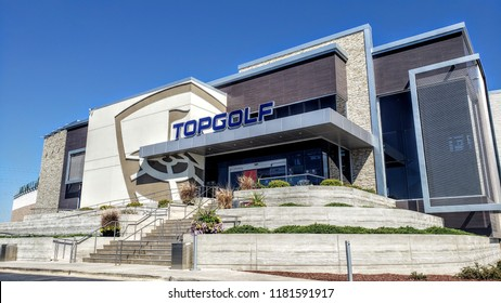 NAPERVILLE, IL, USA - September 14, 2018: Topgolf features three floors of driving range bays and is a fun entertainment complex for all ages to enjoy.