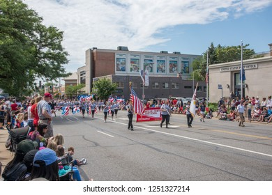 Naperville, Illinois/United States - May 29,2017: Memorial Day parade with Naperville Central High School marching with flags in downtown Naperville, Illinois