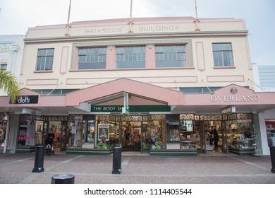 Napier, Hawke's Bay/New Zealand-December 15,2016: Briascos' Buildings with art deco storefronts and tourists in downtown Napier, New Zealand