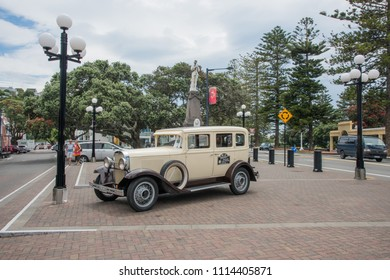 Napier, Hawke's Bay/New Zealand-December 15,2016: Hooters Vintage Car Tour vehicle and South African War Memorial in Napier, New Zealand