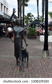 Napier, New Zealand, December 24, 2018: Bronze sculpture called A Wave in Time in Napier, New Zealand, created by Mark Whyte and depiciting Miss Sheila Williams