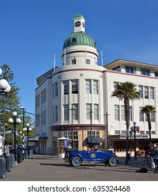 Napier - New Zeland - April 27, 2017: The T&G Building Is an example of the Art Deco style of architecture from the early 1930's. In the foreground is a vintage car from the same era.