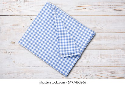 Napkin. Kitchen towel or table cloth on white wooden scene. Mock up for design. Top view mockup.