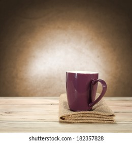napkin mug and wall with light