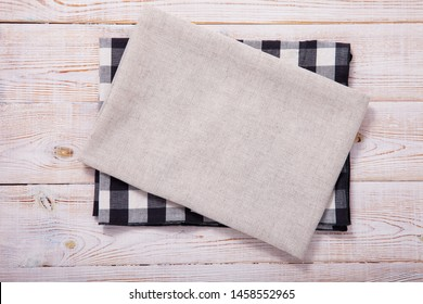 Napkin on white wooden table. Mockup for design. Top view.