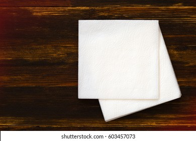 Napkin on wooden background.