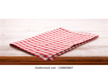Napkin on wooden table isolated on white. Multi-colored linen napkins for restaurant. Mock up for design. Top view square.