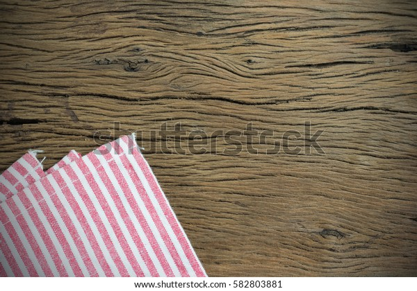 Napkin white switching red on old wooden background. with copy space for text.
