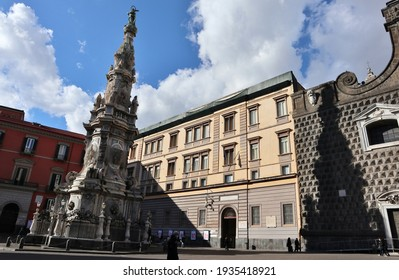 Naples, Campania, Italy - January 19, 2021: Eighteenth-century obelisk dedicated to the Immaculate Conception, also known as the Spire of the Immaculate Conception, in Piazza del Gesù Nuovo