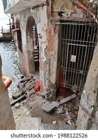 Naples, Campania, Italy - May 20, 2021: Dilapidated house on the sea at the end of the staircase of Descent San Pietro 2 Frati from Via Posillipo