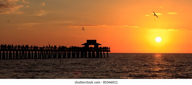 Naples fishing pier at sunset in Florida.