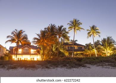 Naples, Fl, USA - March 19, 2017: Beautiful waterfront villas in Naples illuminated at night. Florida, United States