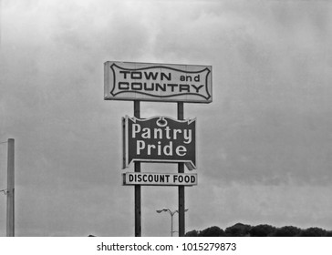 NAPLES, FLORIDA – SEPTEMBER 8, 1979: Town and country sign. Vintage picture taken in 1979.