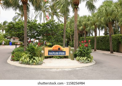 NAPLES, FLORIDA, USA - AUGUST:   Entrance to the Naples Pier, recently re-opened after being closed due to Hurricane Irma damage in 2017 as seen on August 1, 2018.